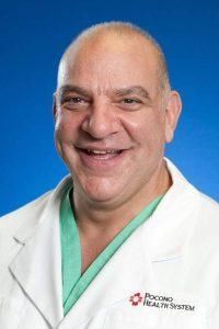 Dr. Musa Tangoren