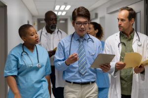 Diverse group of male and female doctors walking through corridor discussing. medicine, health and healthcare services
